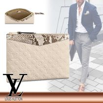 Louis Vuitton Leather Logo Clutches
