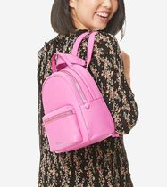 Cole Haan Plain Leather Backpacks
