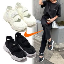 Nike AIR RIFT Platform Logo Platform & Wedge Sneakers