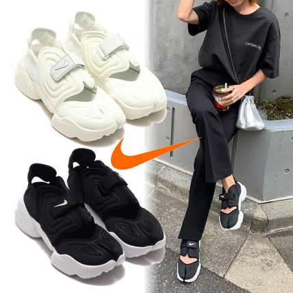 Nike AIR RIFT Logo Platform Platform & Wedge Sneakers