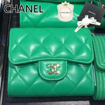 CHANEL Plain Leather Logo Folding Wallets