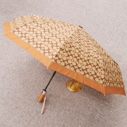 Coach Unisex Umbrellas & Rain Goods