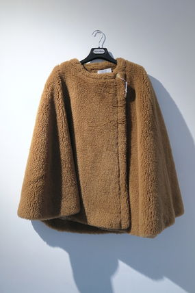 Shearling Ponchos & Capes