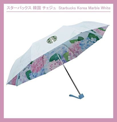 STARBUCKS Umbrellas & Rain Goods